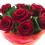 En bild på ett fång röda rosor