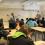En bild från turnén we_change. I ett gymnasieklassrum samtalar två vuxna med ett antal gymnasieelever . På talvan står ord som psykisk ohälsa och självkänsla.