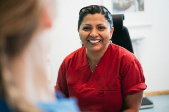 Female healthcare worker smiling