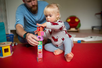 Father and daughter building a tower